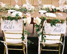 wooden head table bride and groom calligraphy chair signs at Degolyer House Dallas Arboretum wedding reception