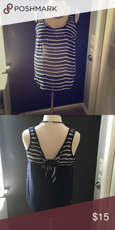 Striped top Blue and white. Front is sheer back is solid with cut out and bow. Worn once Tops