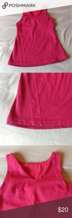 Lululemon tank top size 6 Lululemon active tank top size 6. Pink with some color fading. Pocket with working zipper, built-in bra, small cut out on back. Used and in fair condition lululemon athletica Tops Tank Tops