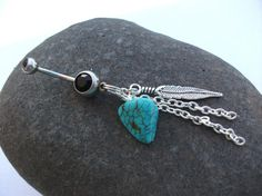 this one is really cool!   Turquoise Feather Dangle Hippy Boho Belly Ring by EleganceAndGrace, $13.00