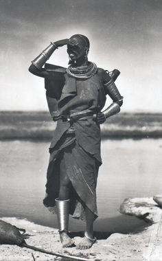 Africa | Massai woman in Kenya.  ca. 1924 - 1941. | Scanned vintage postcard;  photographer Casimir Zagourski