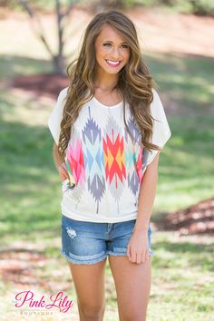 This trendy arrow print top is perfect for spring and summer! This top features an aztec arrow design in a rainbow of colors wrapped around the front and back.