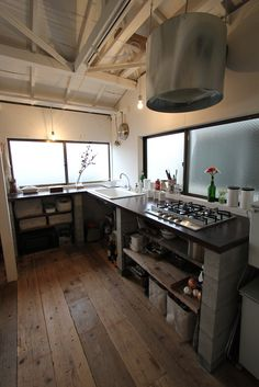 Open shelving through the corner, eliminate upper cupboard and hang pans or hang tansu cupboard