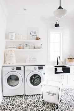 White laundry room with shiplap walls and cement floor tile. Bright white…