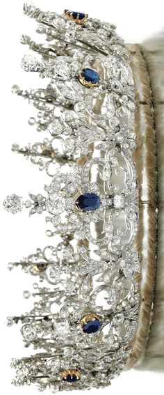 I need a tiara for when I am working in my Sparkle Cave...#justsaying #princesscomplex The tiara was designed by Prince Albert for Queen Victoria, is set with sapphires and diamonds and can be seen in the portrait of the Queen by Winterhalter in 1842.