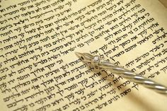 """yad--one does not touch the torah with the hand, both out of respect and to preserve it.   Here it is pointing to the hebrew word """"israel"""".  Yad is the Hebrew word for """"hand""""."""