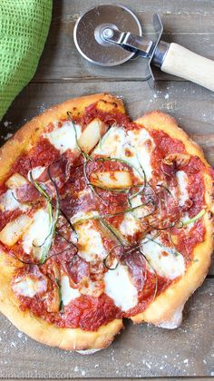Kimchi Prosciutto Pizza is spicy, salty, smokey and extremely addicting! Gochujang and kimchi make this pizza extra tasty. Trust me, it'll be a huge hit at your next pizza party  kimchichick.com