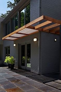 A very modern and simple awning with louvers on one side