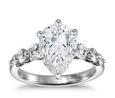 Exquisite in every way, this diamond engagement ring showcases six round diamonds that taper in size and are intricately hand-set in enduring platinum. Setting includes ¾ carat total diamond weight.