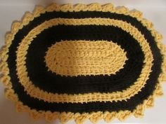 Rag Rug crocheted in yellow and black cotton yarn using eight strands through out.