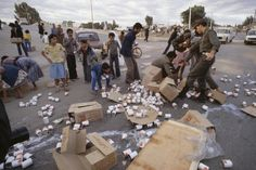 Algeria. El Asnam. A massive earthquake in which up to 10,000 people are thought to have died. People helping themselves to emergency food supplies. 1980.
