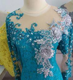 No photo description available. Dress Brukat, Kebaya Dress, Batik Dress, Lace Dress, Teal Blue Weddings, Jumpsuit For Wedding Guest, Kebaya Brokat, Model Kebaya, Style Haute Couture