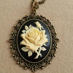 Check out this item in my Etsy shop https://www.etsy.com/listing/210298675/large-resin-roses-cameo-pendant-necklace