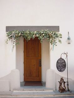 Romantic Rosemary Beach Wedding by Shelby Peaden eucalyptus garland over the door Eucalyptus Garland, Eucalyptus Wedding, Green Wedding, Floral Wedding, Wedding Flowers, Garland Wedding, Wedding Decorations, Christmas Decorations, Rosemary Beach