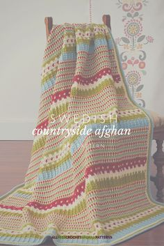 This afghan reminds me of traditional Swedish designs and the pretty colors of the Swedish landscape. It's so lovely!