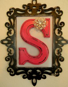 Monogram Initial (wooden, any letter, any color) with a frame around it- so cute especially with the flower