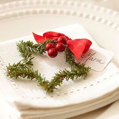 Christmas Place Setting...a simple star made from a piece of artificial pine, with berries, red bow, and nametag attached to it.  Could also use these as sweet holiday gift tags.