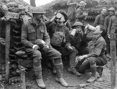 After taking a town, men of the 132nd Infantry celebrate with German beer and cigars. - The spoils of victory enjoyed as they were meant to be