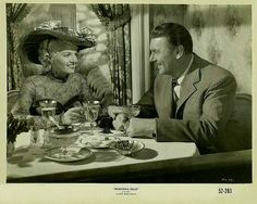 "MONTANA BELLE (1952) - Jane Russell (who portrays female bandit, ""Belle Starr"") has dinner with wealthy suitor George Brent - RKO-Radio Pictures - Movie Still."