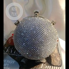 Adorable Crystal Ball Clutch This adorable hard case bag features a metal handle. Includes a removable chain strap and black velveteen lining. Silver Tone hardware. Snap closure. 5 X 5 diameter. Perfect for that special occasion. Price is firm unless bundled or goes on sale. Low offerers will be blocked This closet does it trade or use PayPal) Bags Clutches & Wristlets