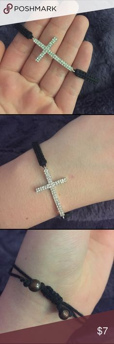 Sideways cross bracelet Sideways cross bracelet. The black part is string that you pull to make it tight/loose and the actual cross is a silver material. Only worn a handful of times - good condition! Jewelry Bracelets