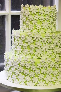 This gorgeous flower filled wedding cake makes a spring or summer wedding spread just perfect. Light, fun, colorful yet simple and elegant!  http://citycakesny.com http://Facebook.com/CityCakes
