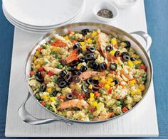 This easy paella recipe has all the flavors of the traditional Spanish dish, but the seafood is limited to shrimp, and quick-cooking couscous replaces the rice.