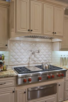 Transitional kitchen with unusual backsplash, pot filler, gas stove, warming drawer, and white cabinets Kitchen Layout, New Kitchen, Kitchen Decor, Kitchen Ideas, Kitchen Designs, American Home Design, Residential Interior Design, Transitional Kitchen, Apartment Kitchen