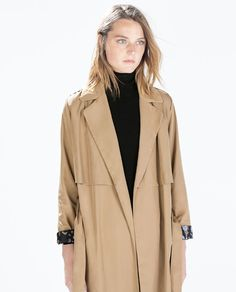 FLOWY TRENCHCOAT WITH CAMOUFLAGE LINING
