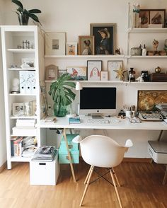 Home office inspiration with white desk, white walls, and gallery wall.