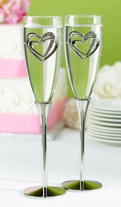 These sparkling heart champagne toasting glasses may be the perfect reception accessory for your wedding day. The wedding toasting glasses stand 10.25 inches tall and feature nickel-plated stems with a band of hearts at the base of the glass bows