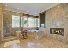 This bathroom fireplace offers a romantic ambiance.