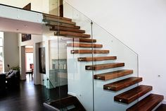 wood floating stairs: modern staircase with wooden steps and glass railing modern stairs designs - wood, metal staircase design ideas Wooden Staircase Design, Wood Railings For Stairs, Cantilever Stairs, Modern Stair Railing, Stair Railing Design, Wooden Staircases, Modern Stairs, Staircase Spindles, Wall Railing