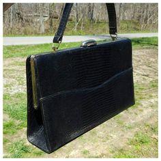 Check out this item in my Etsy shop https://www.etsy.com/listing/275058930/vintage-black-alligator-skin-handbag