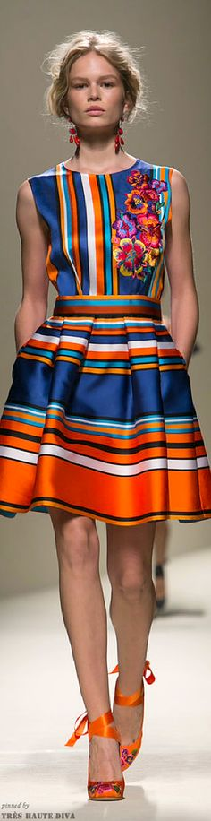 Beautiful Bright Spring colours. Love the rust in the waistband. The dark blue is a nice example of this Season's navy blue.