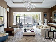 A Tomás Saraceno sculptural chandelier crowns the master bath; the Vladimir Kagan wing chair and Chris Lehrecke daybed are from Ralph Pucci International, and the end tables are by Christian Liaigre | archdigest.com