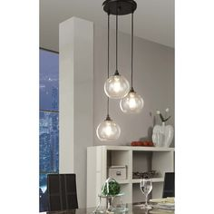Illuminate your Contemporary dining room or entryway with this transparent three-light globe cluster pendant by Uptown. This glass pendant light, constructed of clear glass and metal with a black fini Globe Pendant Light, Pendant Chandelier, Pendant Lighting, Cluster Pendant Light, Crystal Pendant, Unique Lighting, Home Lighting, Lighting Store, Track Lighting Fixtures