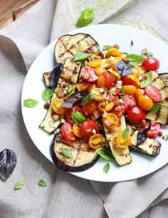 Grilled veggies topped off with fresh tomatoes, basil, chopped almonds, and drizzled with zesty greek vinaigrette. Paleo, Whole30, Tasty, and Healthy!