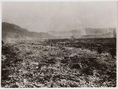 Carl Mydans, [People walking along road through decimated region where atomic bomb dropped, Hiroshima], 1945