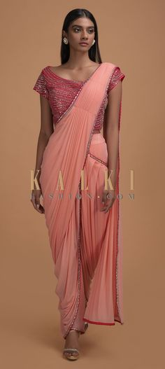Buy Online from the link below. We ship worldwide (Free Shipping over US$100)  Click Anywhere to Tag Salmon-Pink-Ready-Pleated-Dhoti-Saree-With-Hot-Pink-Mirror-Embellished-Blouse-Online-Kalki-Fashion