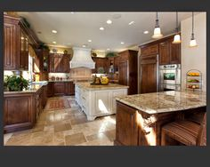 dark cabinets, light counter tops, medium floor with champaign