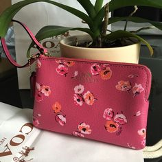 """Coach Wildflower Wristlet NEW COACH CORNER ZIP WRISTLET Gold/Dahlia Zip top closure Inside two slip pockets for cards Strap with 5"""" drop with clip to form a wrist strap or attach to the inside of a bag. Take advantage of bundle discount. Will accept reasonable offers. This is a perfect gift. NWT Coach Bags Clutches & Wristlets"""