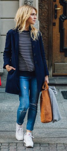 Katarzyna Tusk pairs simple ripped jeans with a casual striped top and a navy overcoat. Top: Mango, Jeans: Zara, Coat: Stefanel.