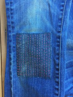 How to sew a sashiko patch on jeans.