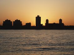 New Jersey's skyline with a spectacular sunset as a backdrop.