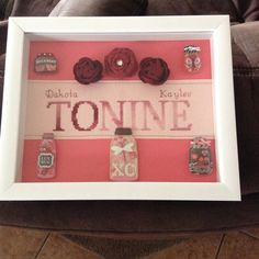 Cross stitched first name with her children's names. Accessories her favorite red roses and lots of love.