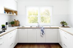 Want to soften a geometric pattern? This bright white kitchen shows us how geometric can be subtle when done with white tile and matching grout. If you like this look, go for our Small Diamonds in White Gloss or White Wash.