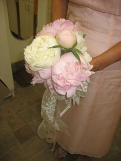 This elegant peony bridesmaid bouquet is made of white and light pink peonies flowers.