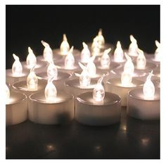 AGPtek® 100 Pack Warm White Flickering and Flameless Tealight Candles Battery (included) Operated: Amazon.co.uk: Lighting