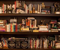 Lauren Santo Domingo's lending library -- I love the way the books are stacked in different directions...